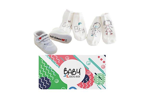 Pojke eller flicka babybox med babyskor och babysockor